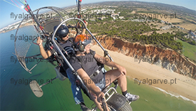 fly-paragliding with motor- over algarve beach
